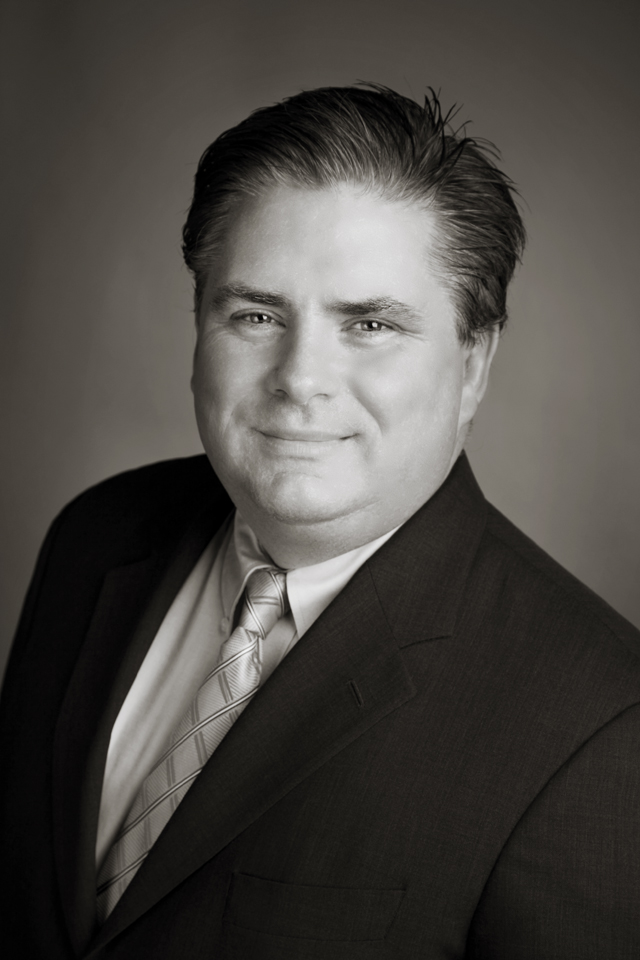 A photograph of Greg Essensa, Chief Electoral Officer of Ontario